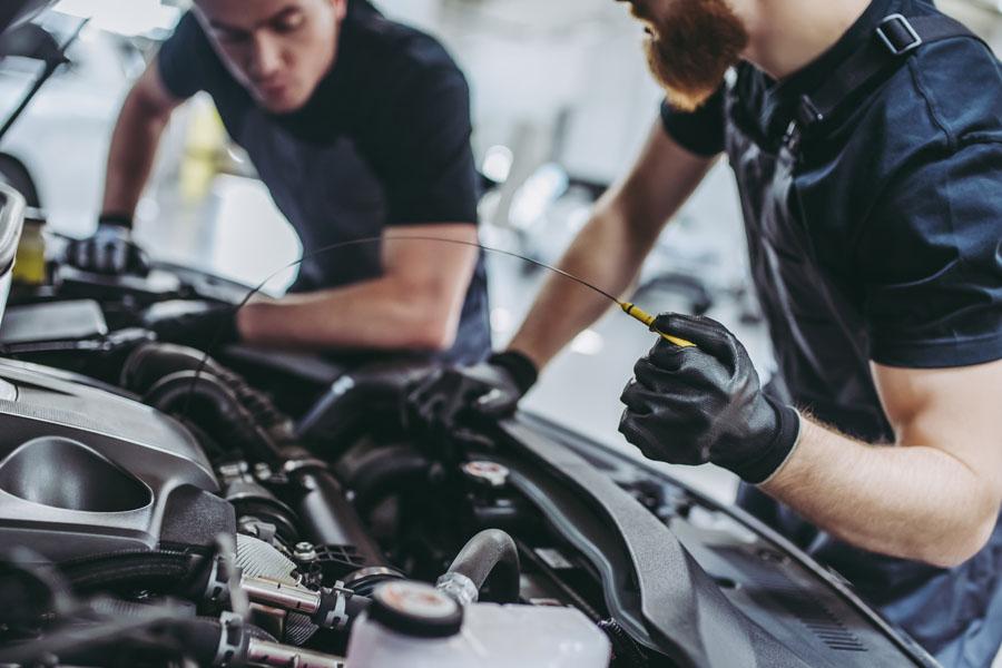 Garage Repair Shop Insurance - Mechanics Changing Oil in the Car