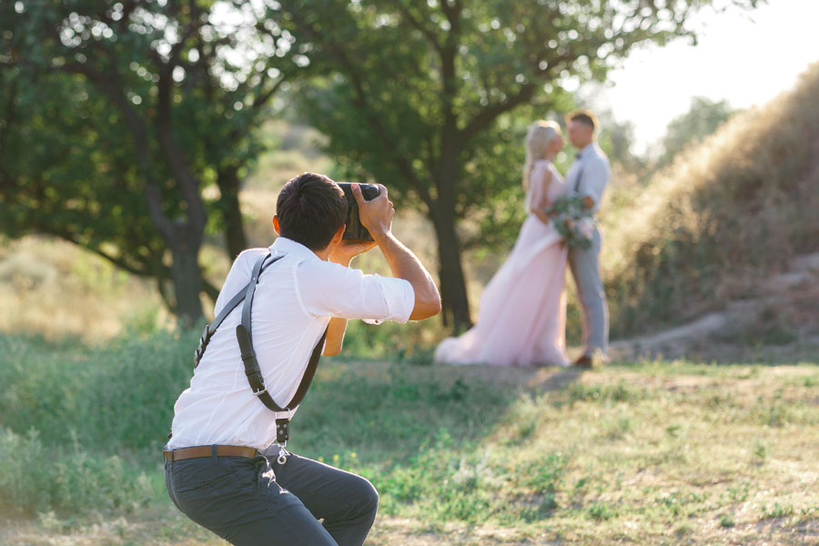 Professional Services Insurance - Wedding Photographer Capturing the Perfect Shot