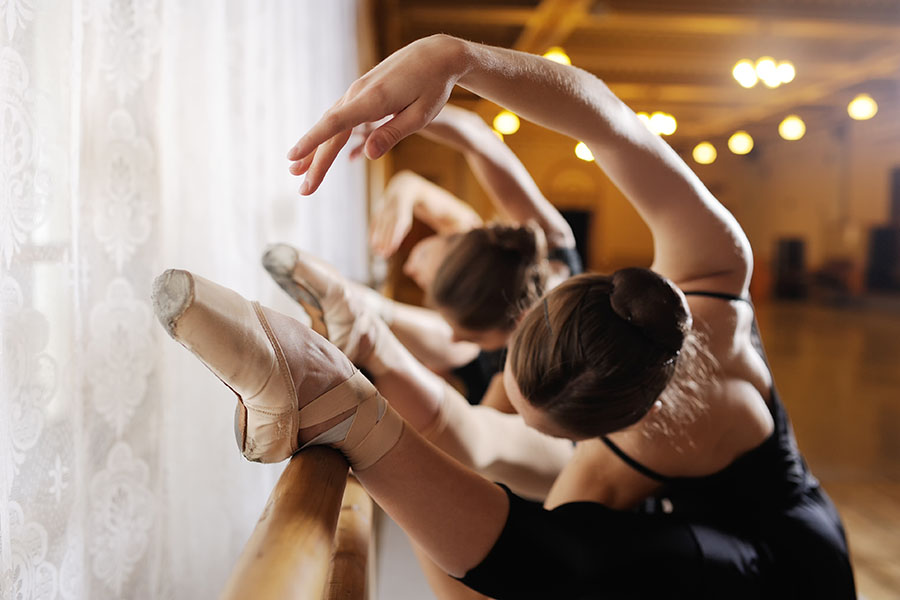 Specialized Business Insurance - Line Of Young Girls Practicing Ballet On Barre In Dance Studio